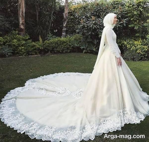 لباس عروس آستین دار با طرحی تماشایی