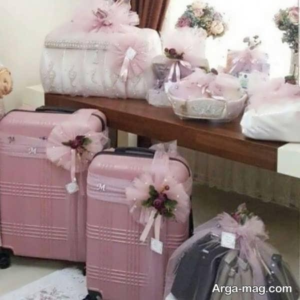 تزیینات دوست داشتنی چمدان عروس و داماد