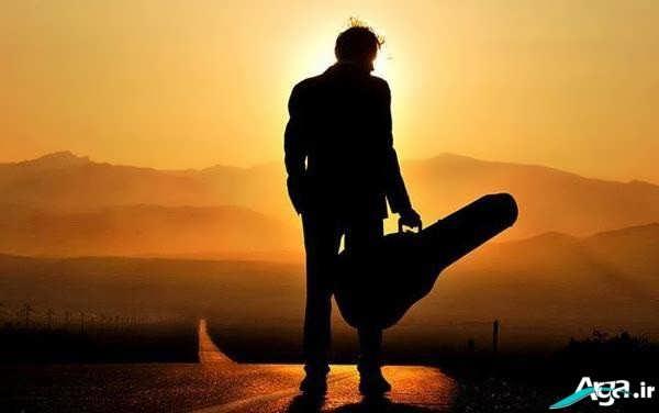 عکس پسر تنها و گیتار