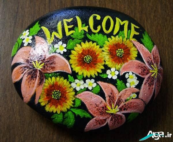 نقاشی گل روی سنگ