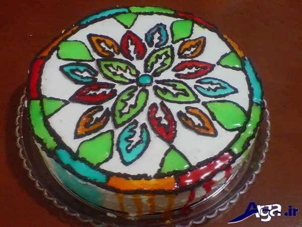 تززین ساده کیک خانگی با ژله و خامه