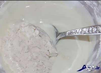 افزودن آرد به مایع زولبیا