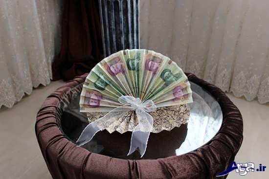 تزیین جدید پول به شکل بادبزن
