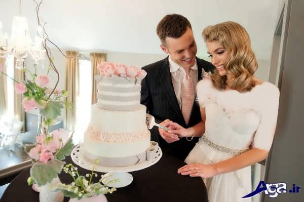 عکس عروس و داماد با کیک عروسی