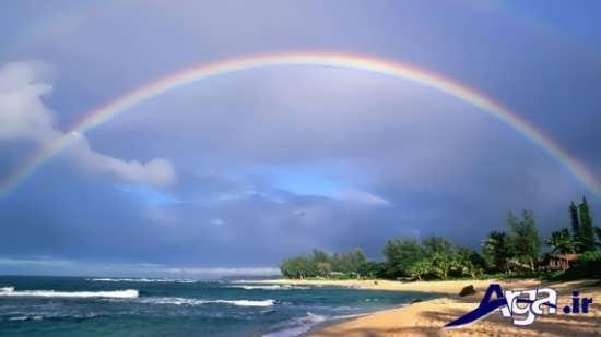 عکس رنگین کمان زیبا در ساحل