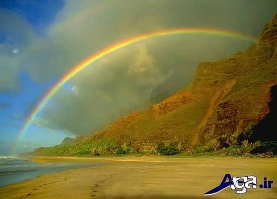 عکس رنگین کمان در کنار دریا