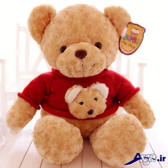 عکس خرس عروسکی با لباس قرمز