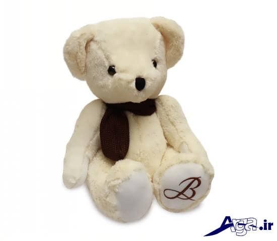 عکس خرس عروسکی سفید با دستمال گردن