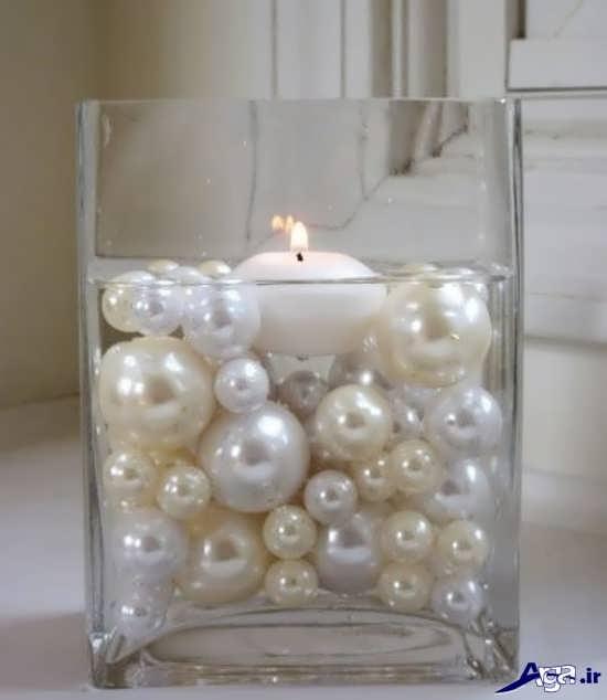 تزیین شمع با مرواریدهای رنگی