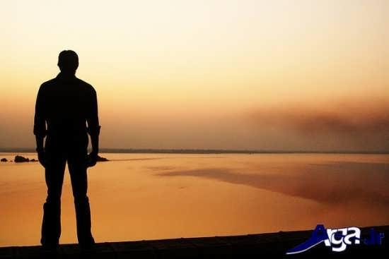 عکس های زیبای تنهایی پسر غروب دریا