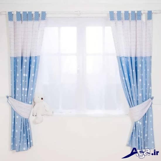 پرده سفید و آبی برای اتاق نوزاد