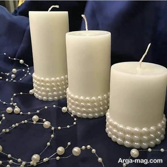 تزیینات هنرمندانه شمع با مروارید و نگین