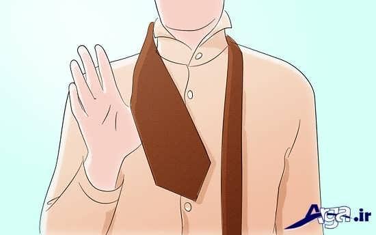 انداختن صحیح کراوات بر روی گردن برای بستن گره ساده