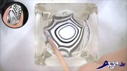 ایجاد کردن طرح لاک با کمک خلال دندان در درون آب