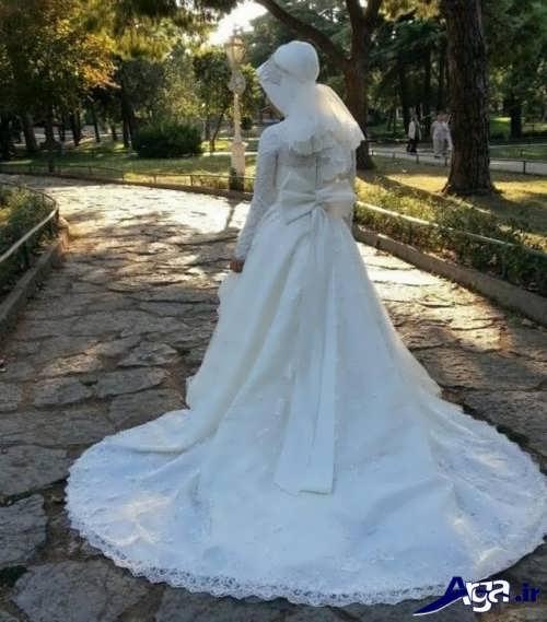 مدل لباس عروس پوشیده دنباله دار