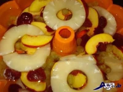 چیدن برش های میوه در درون قالب ژله