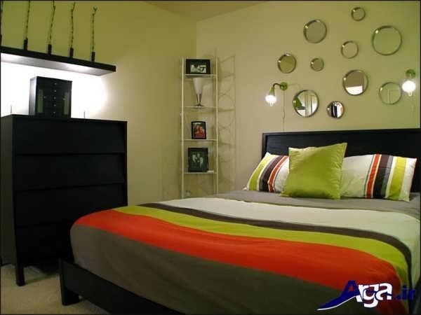 تزیین دیوار اتاق خواب با کمک آینه