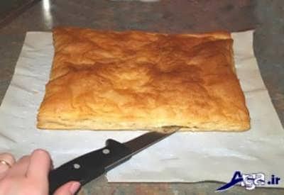بش دادن نان شیرینی به دو قسمت