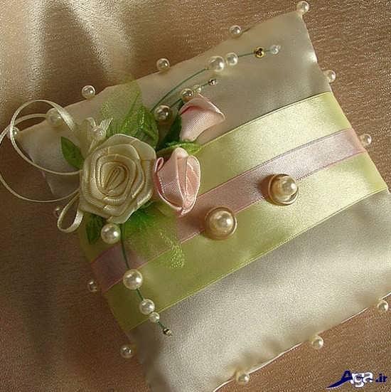 تزیین حلقه عروس با گل طبیعی