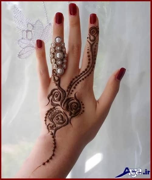 طرح های زیبا و خلاقانه حنا روی دست