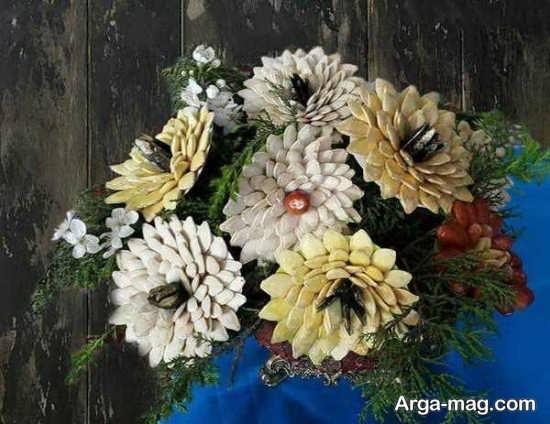 تزیین هنرمندانه خشکبار شب یلدا به شکل گل