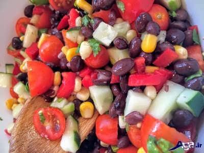 مخلوط گوجه و لوبیا و گشنیز و پیاز