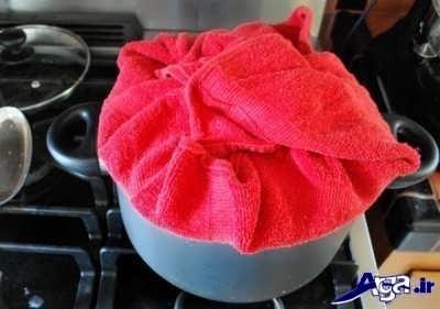 قرار دادن دم کنی روی قابلمه برنج