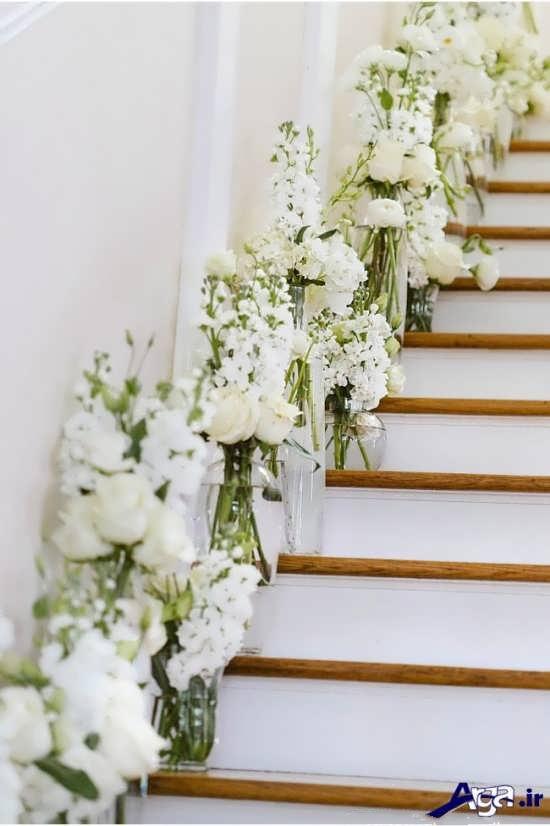 تزیین راه پله با گلدان و وسایل ساده