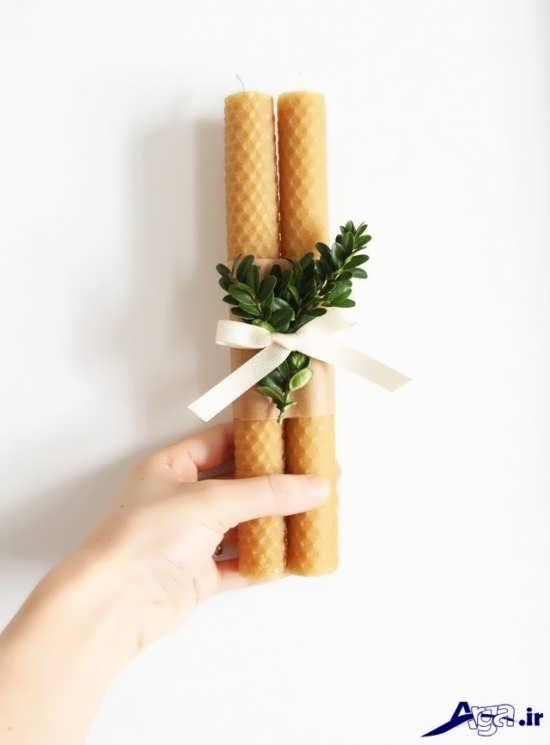 تزیین شمع با روبان و برگ های طبیعی