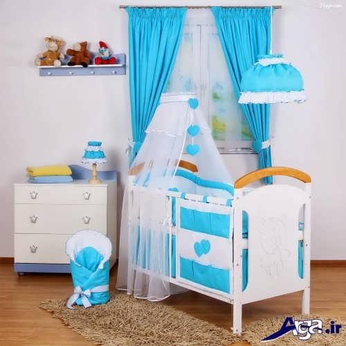 دکوراسیون آبی و سفید اتاق نوزاد