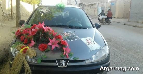 تزیین ماشین 206 برای عروسی با عکس شهدا و دسته گل
