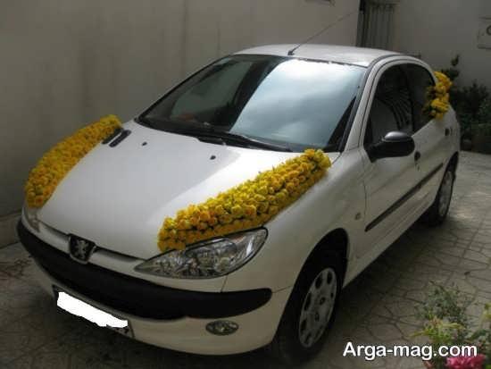 تزیین ماشین عروس 206 با گل زرد