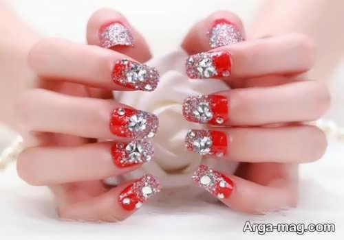 آرایش ناخن لاک قرمز و نقره ای