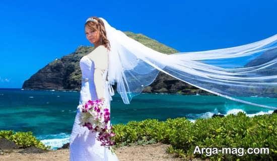 ژست عکس عروس در کنار دریا