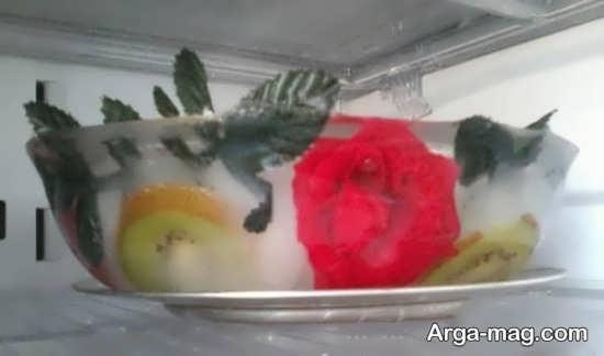 تزیین زیبا یخ عروس با میوه و گل