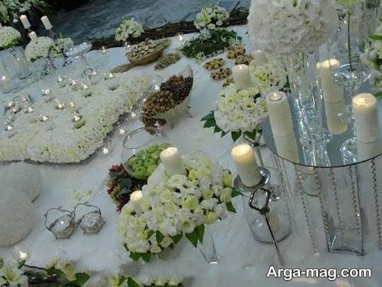 تزئین سفره عقد با گل و شمع