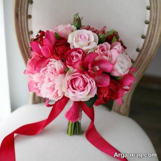 تزیین گدسته گل عروس با گل های صورتی