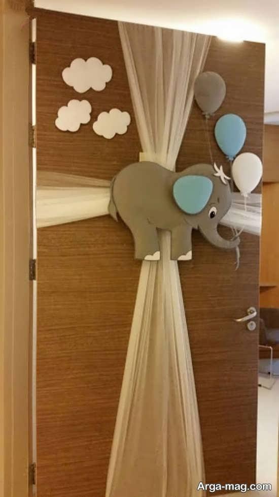 تزیینات فانتزی درب اتاق نوزاد