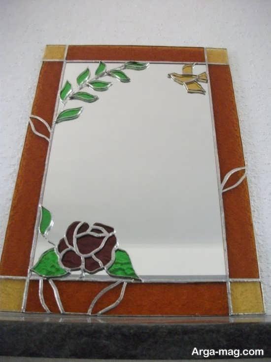 نقش برجسته گل روی آینه