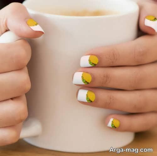 طراحی ناخن با لاک زرد و سفید