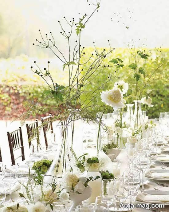 طراحی شیک میز شام عروسی با گل