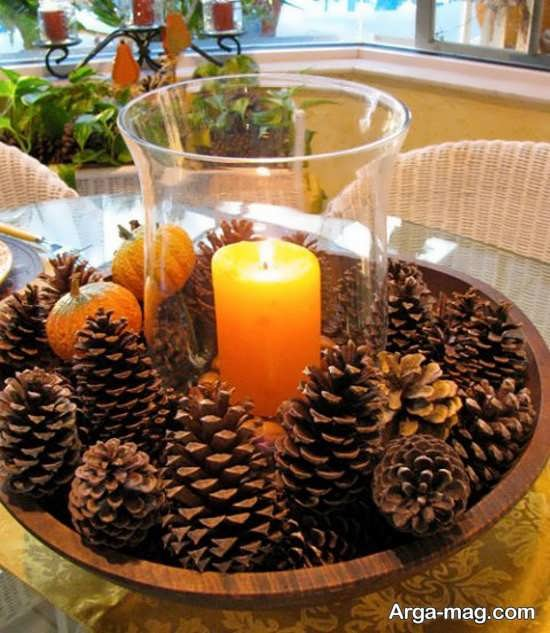 طراحی زیبای شمع با میوه کاج