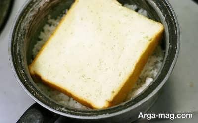 از بین بردن بوی بد سوختگی برنج با نان