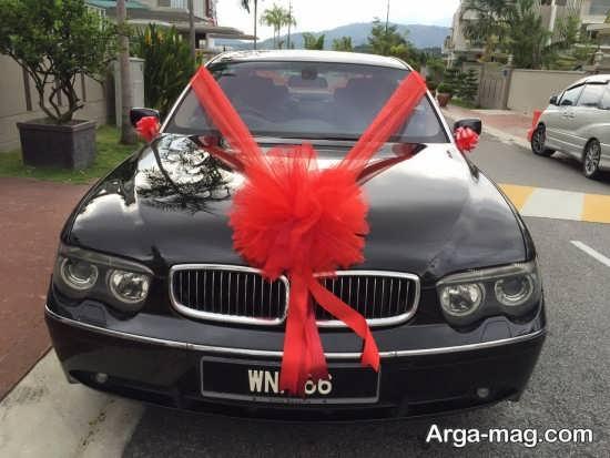 تزیین ماشین عروس مشکی با تور قرمز