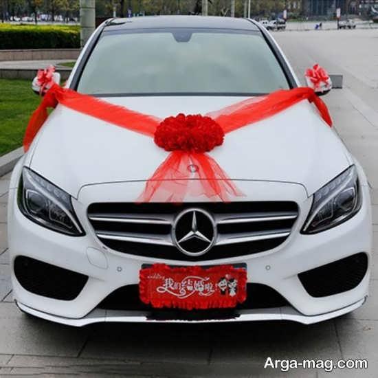 تزیین ماشین عروس سفید با تور قرمز