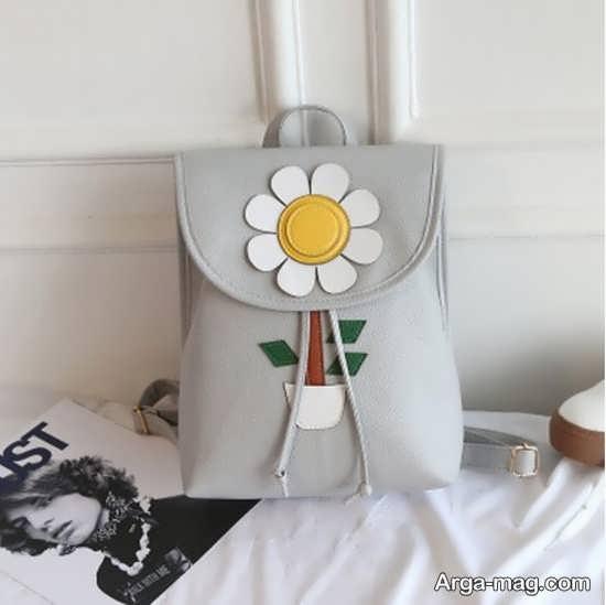 تزیین کیف به شکل گل آفتاب گردان