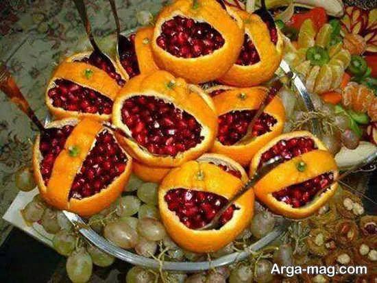 تزیین پرتقال با انار دون شده شب یلدا