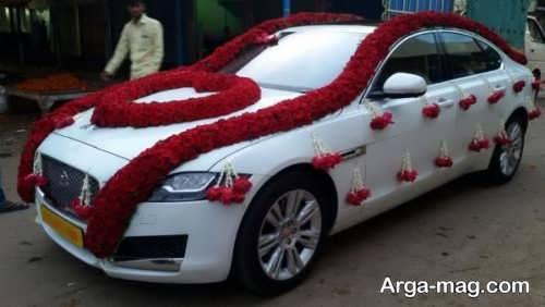 تزیین ماشین عروس با گل قرمز