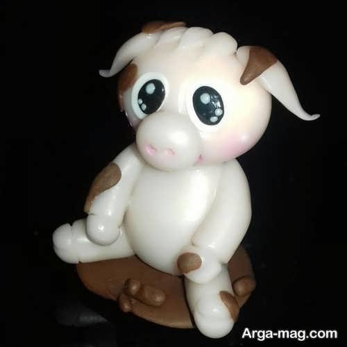 عروسک سفید و قهوه ای خوک