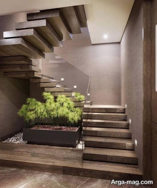 دیزاین قشنگ زیر راه پله با گل های طبیعی